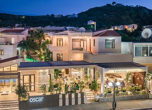 The front of Oscar Suites & Village in Platanias, Chania, Crete at night.