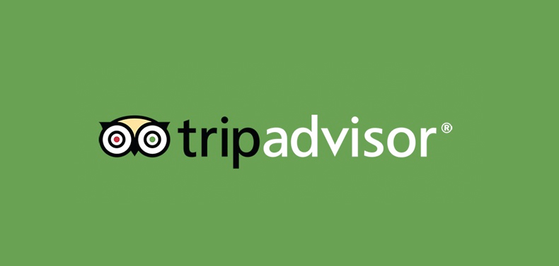 The logo of TripAdvisor on which anyone can read the reviews of the hotel guests.