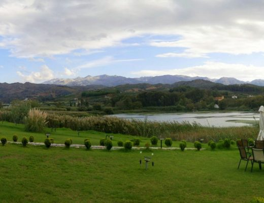 Green grass, trees and a lake in Chania, Crete where Oscar Suites & Village is located.
