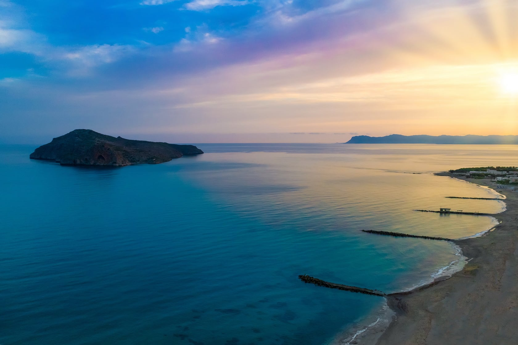 The beach of Agia Marina - Platanias where the Oscar Suites & Village hotel is located.