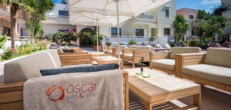 Sofas and coffee tables at the garden of Oscar Suites & Village in Platanias, Chania, Crete.