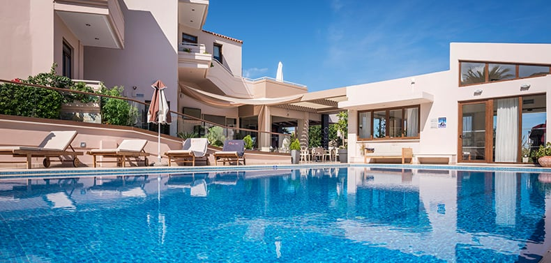 Crystal clear swimming pool in Oscar Suites & Village hotel in Platanias, Chania, Crete.