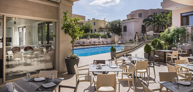 The outside area of Valentino Pasta & Grill restaurant. View of the swimming pool.