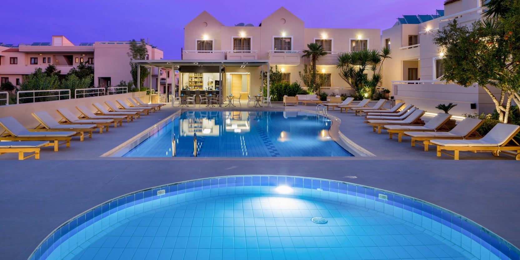View of the two swimming pools in the Oscar Suites & Village hotel in Chania.