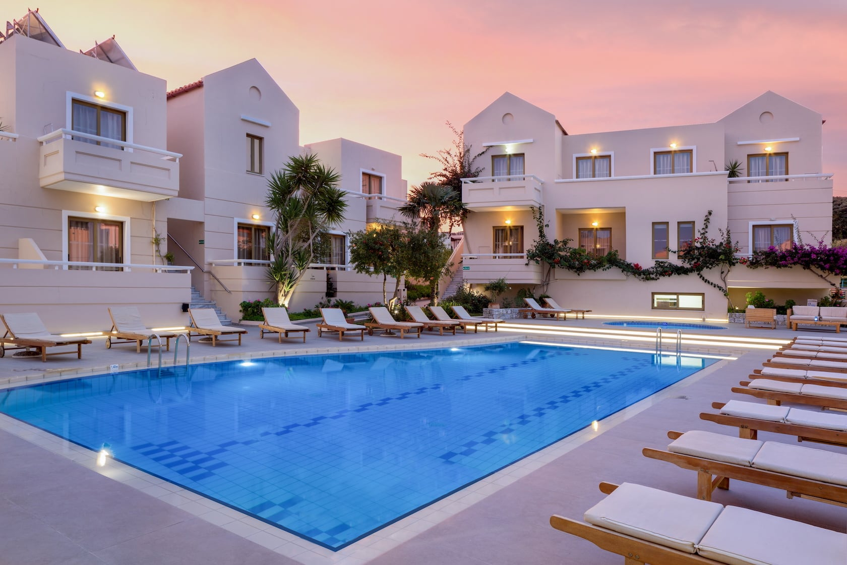 Dusk at the pool area in Oscar Suites & Village in Agia Marina-Platanias in Chania.
