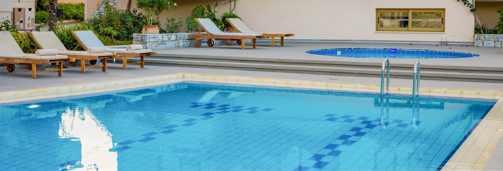 Sunbeds by the pool in the Oscar Suites & Village hotel in Chania, Crete.