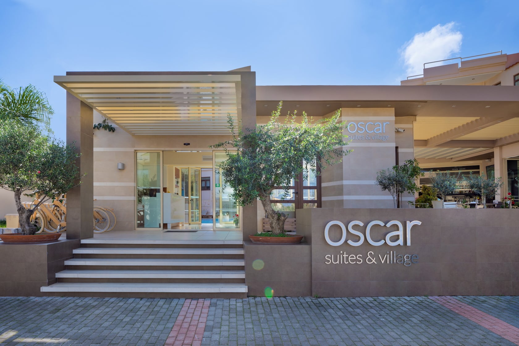 Front of the Oscar Suites & Village displaying the logo of the hotel in Agia Marina in Chania, Crete