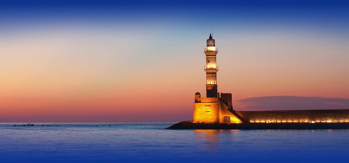 The Egyptian lighthouse in Chania at night. The lighthouse was built by the Venetians.
