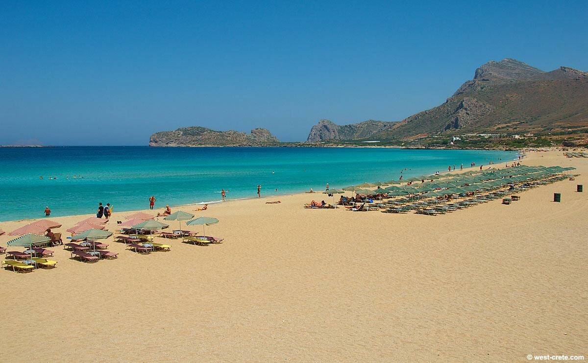 Golden sand and crystal clear sea at a beach in Chania, Crete.