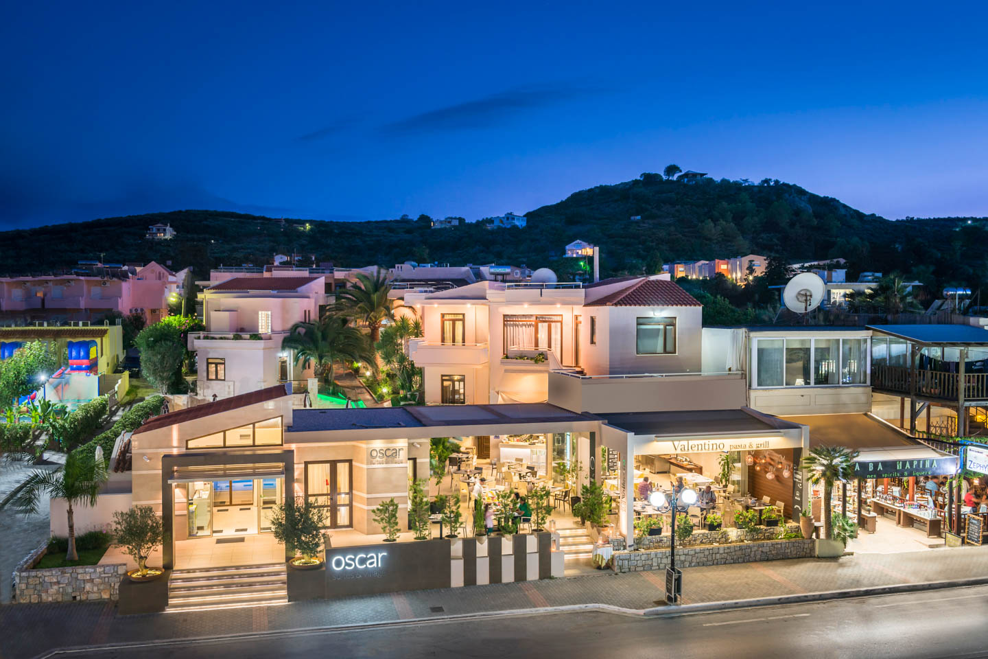 Night at the exterior of Oscar Suites & Village hotel in Platanias, Chania, Crete.