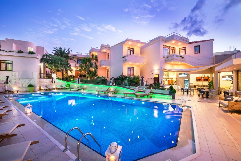 Sizeable swimming pool and the exterior of Oscar Suites & Village in Platanias, Crete.