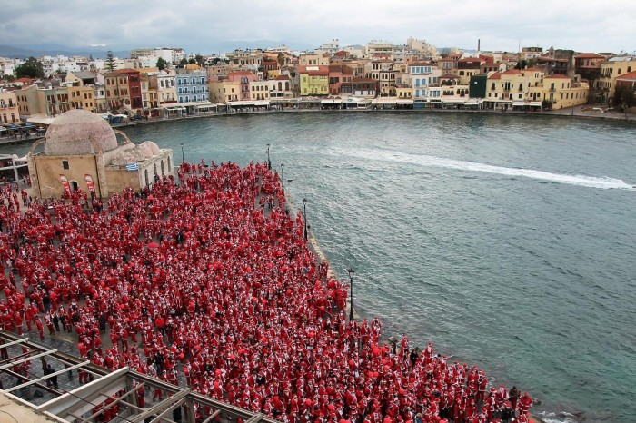 People dressed like Santa Claus at the port of Chania in Crete where Oscar Suites & Village.