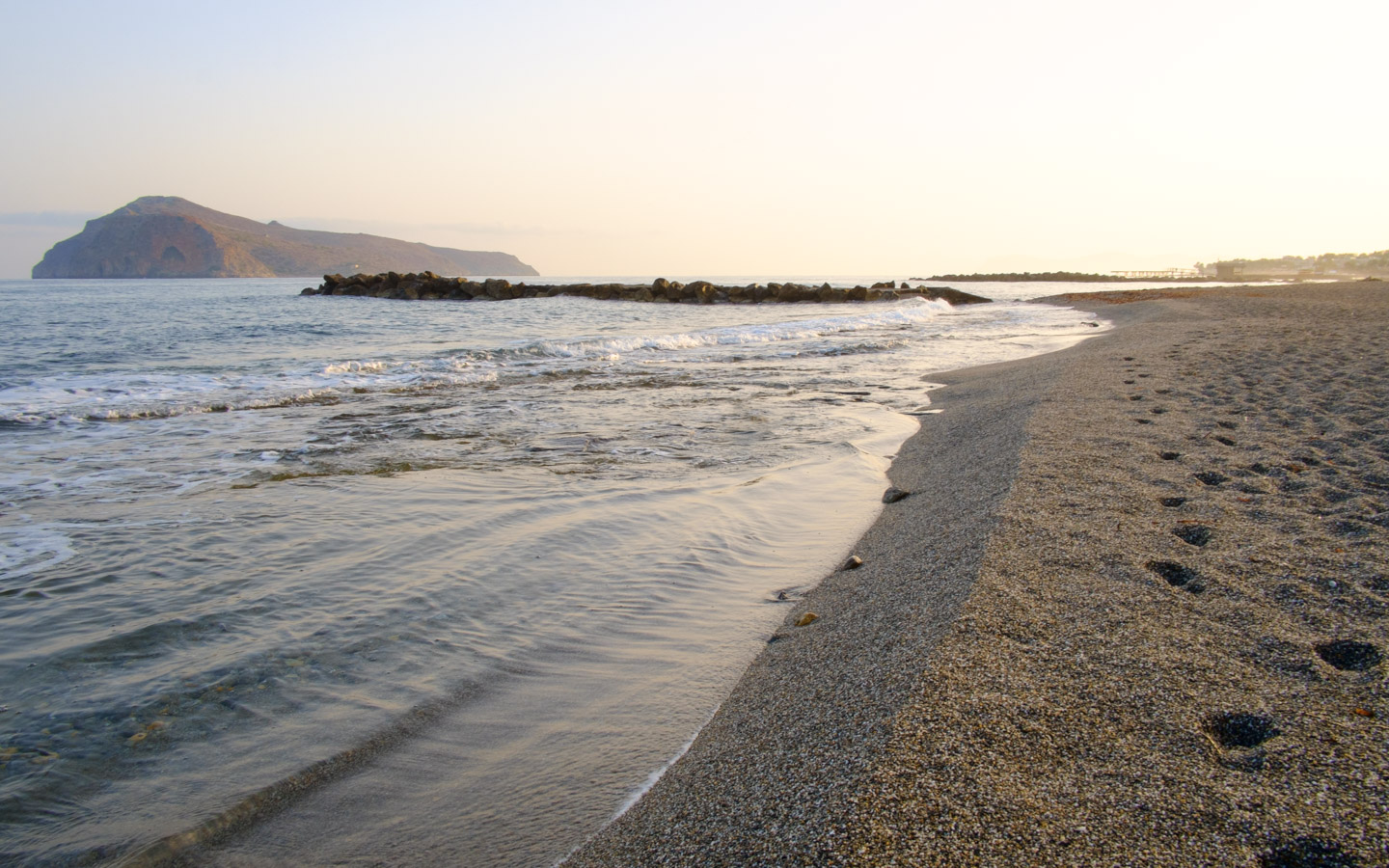 The beach of Agia Marina Platanias is a place to visit in Crete. Crystal clear sea and golden sand.