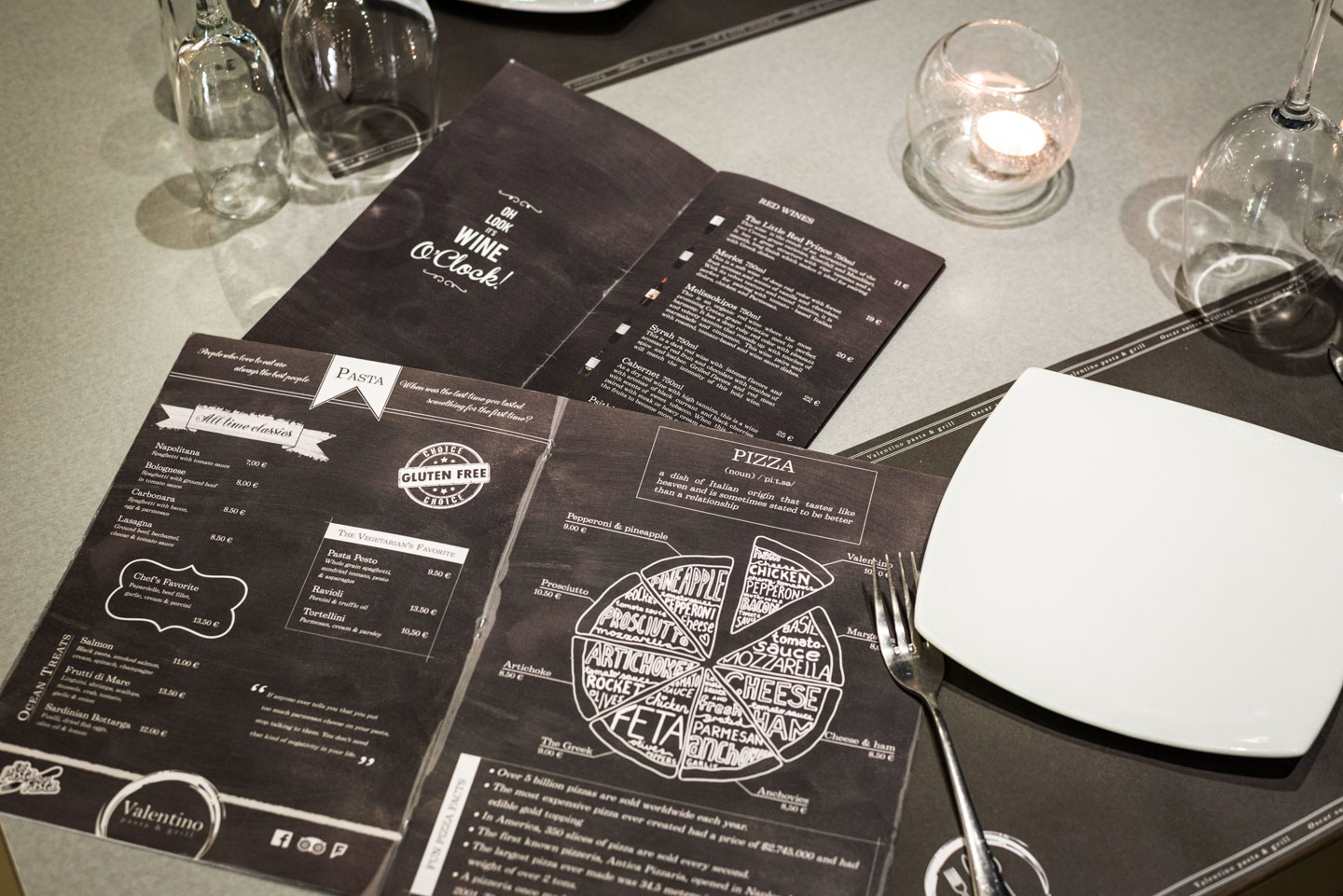 Menus on a table in Valentino Pasta & Grill in Oscar Suites & Village hotel in Platanias.