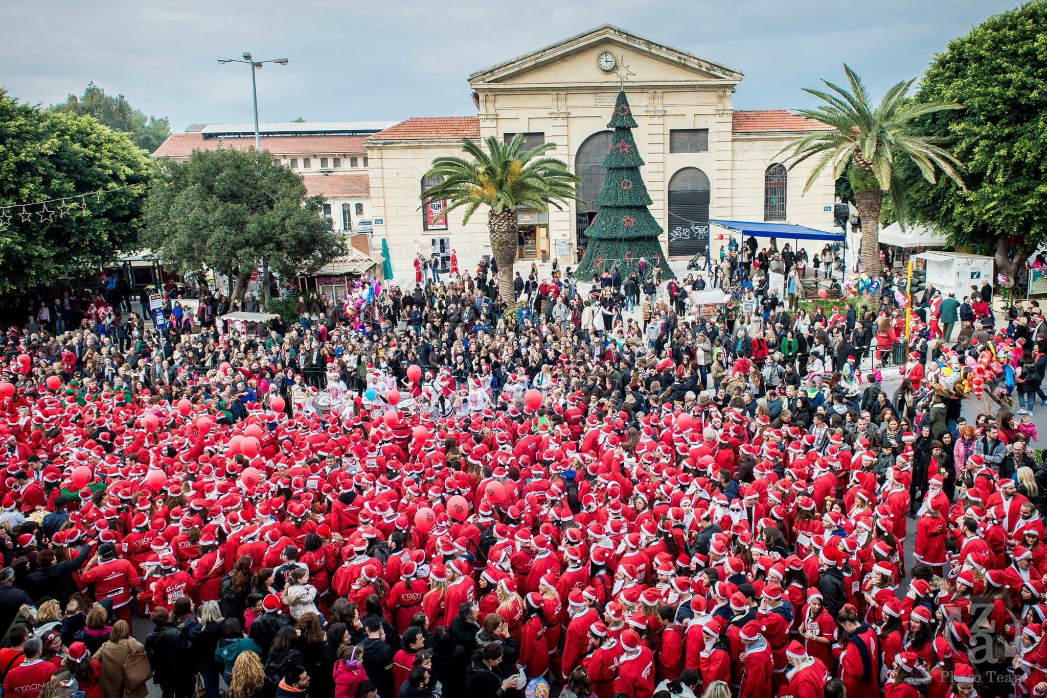 Men dressed like Santa Claus preparing for the Santa run in Chania, Crete.